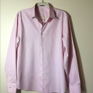 Gotta love the pink shirt! Great condition.
